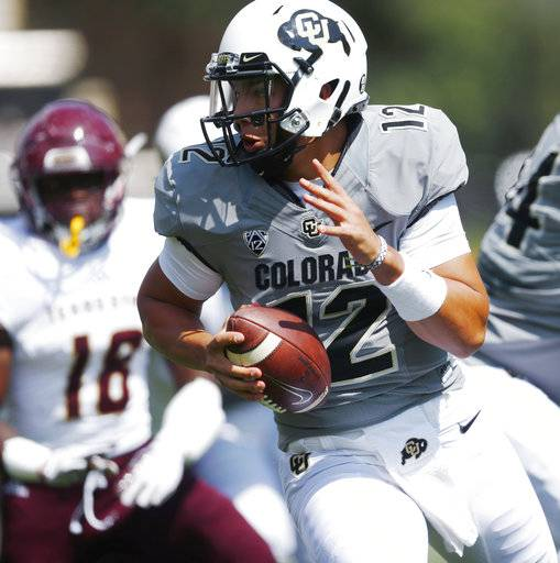 Colorado quarterback Steven Montez, front, scrambles to evade Texas State linebacker Frankie Griffin in the first half of an NCAA college football game Saturday, Sept. 9, 2017, in Boulder, Colo. (AP Photo/David Zalubowski)
