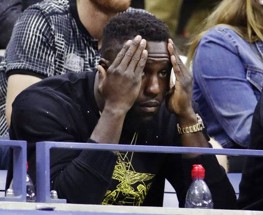 Toronto FC forward Jozy Altidore watches play between Sloane Stephens, of the United States, and Venus Williams, of the United States, during the semifinals of the U.S. Open tennis tournament, Thursday, Sept. 7, 2017, in New York. (AP Photo/Julio Cortez)