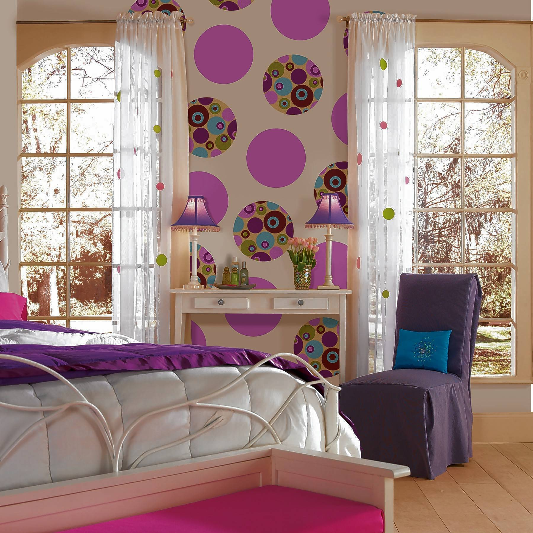 Peel-and-stick decals can be used to complement colors of the bedding, window treatments and decorative items.