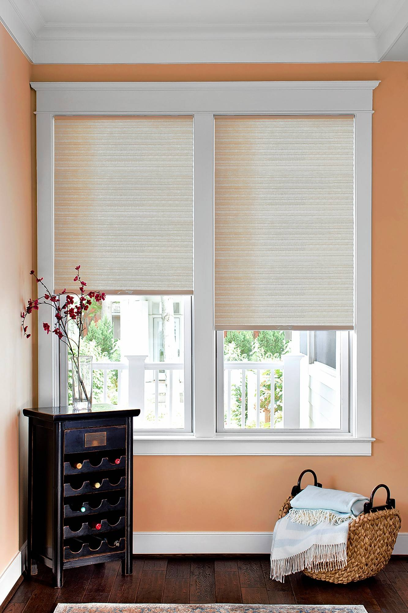 Some types of blinds, such as Next Day Blinds' Honeycomb Shades, allow light to come in while still providing privacy.