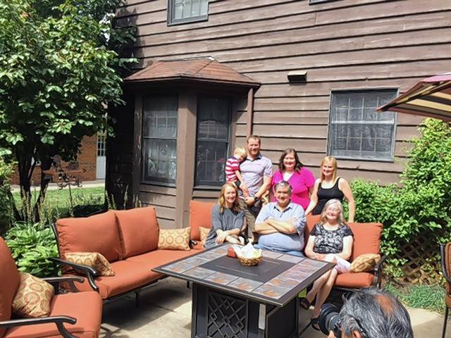 The Allison family gathers around their new fire pit table from Northwest Metalcraft in Arlington Heights, part of their Get Your Summer On prize package.