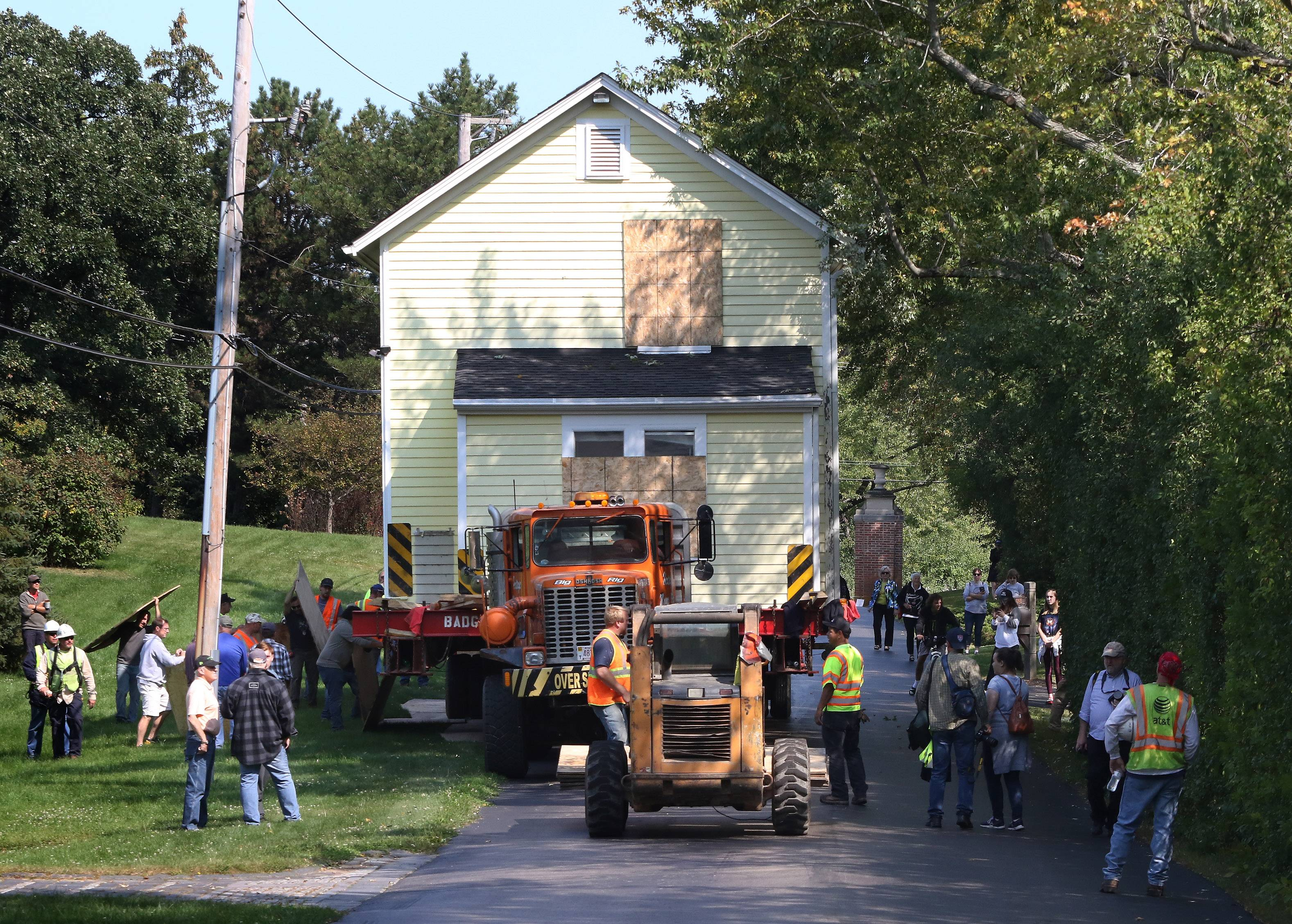 A 19th century house is moved Sunday along Oakdene Road in Barrington Hills. The move drew a crowd along the route from the house's starting point near downtown Barrington.