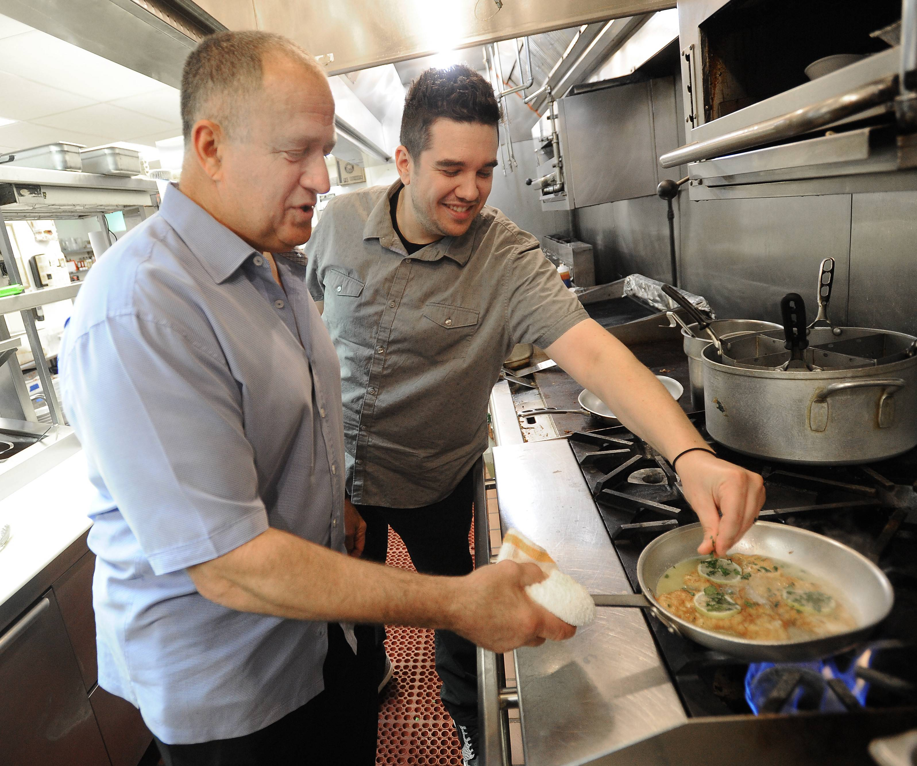 Butch Navarro and his son Mike Navarro, both of Elmhurst, are in charge of the kitchen management at Durty Nellie's in Palatine.