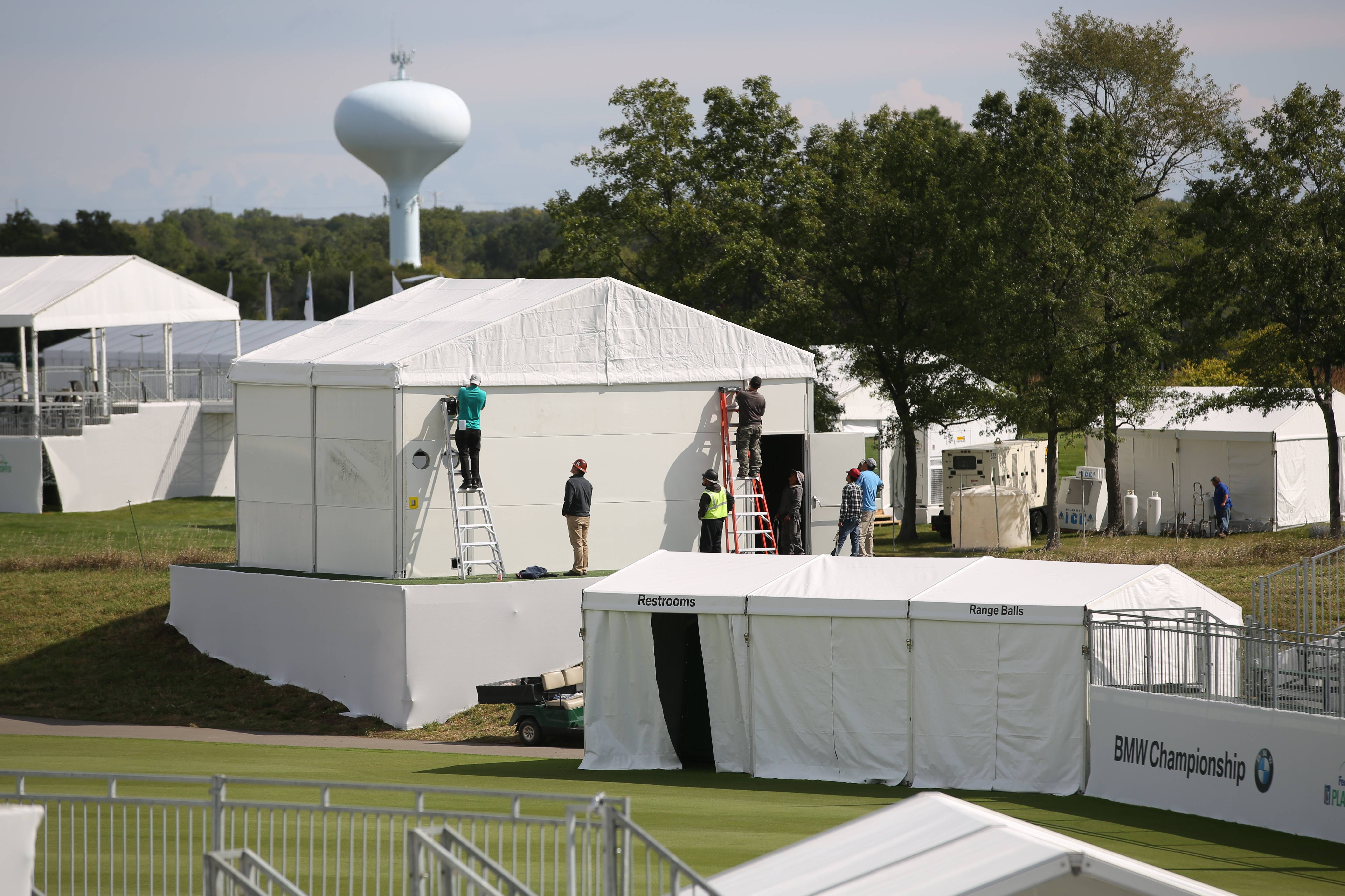 Workers assemble tents for the BMW Championship golf tournament, which begins play Thursday at Conway Farms in Lake Forest.