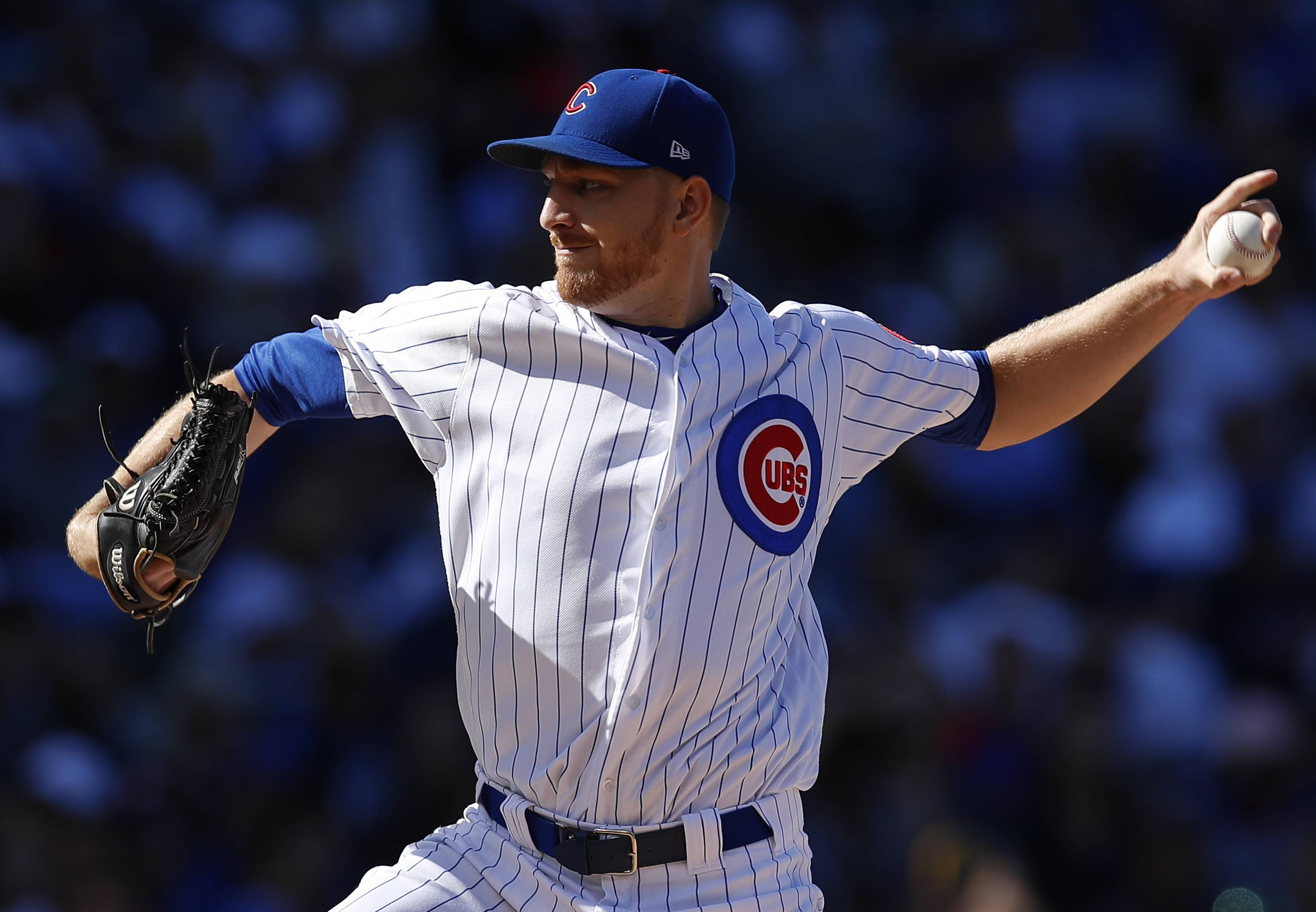 Chicago Cubs' Mike Montgomery pitches against the Milwaukee Brewers during the first inning of a baseball game, Saturday, Sept. 9, 2017, in Chicago. (AP Photo/Jim Young)
