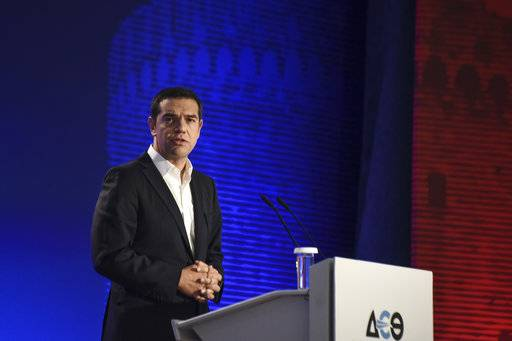 Greece's Prime Minister Alexis Tsipras addresses attendants at the inauguration ceremony of Thessaloniki International Trade Fair, at the northern Greek city of Thessaloniki, Saturday, Sept. 9, 2017. As the Greek Prime Minister was delivering his speech hundreds of protesters were holding anti-austerity rallies outside the premises of the fair. (AP Photo/Giannis Papanikos)