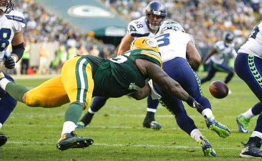 Green Bay Packers' Mike Daniels causes Seattle Seahawks' Russell Wilson to fumble during the second half of an NFL football game Sunday, Sept. 10, 2017, in Green Bay, Wis. The Packers recovered the ball. (AP Photo/Mike Roemer)