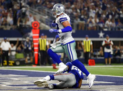 Dallas Cowboys tight end Jason Witten (82) catches a touchdown pass in front of New York Giants cornerback Eli Apple (24) in the first half of an NFL football game, Sunday, Sept. 10, 2017, in Arlington, Texas. (AP Photo/Ron Jenkins)