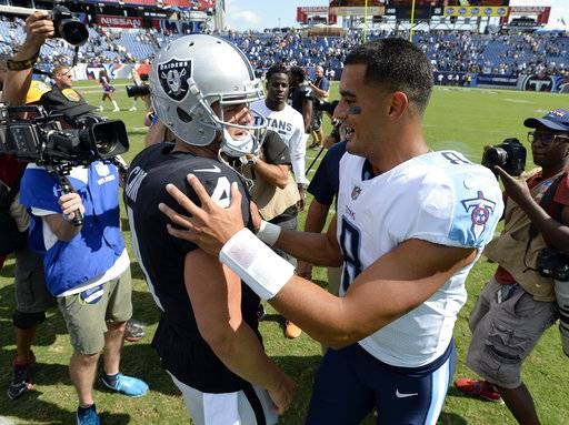 Oakland Raiders quarterback Derek Carr (4) and Tennessee Titans quarterback Marcus Mariota (8) talk after an NFL football game Sunday, Sept. 10, 2017, in Nashville, Tenn. The Raiders won 26-16.(AP Photo/Mark Zaleski)
