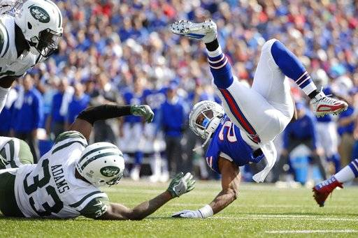 Buffalo Bills running back LeSean McCoy (25) is tackled by New York Jets' Jamal Adams (33) as Muhammad Wilkerson (96) watches during the second half of an NFL football game, Sunday, Sept. 10, 2017, in Orchard Park, N.Y. (AP Photo/Adrian Kraus)