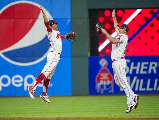 Cleveland Indians' Francisco Lindor, left, and Jay Bruce celebrate after defeating the Baltimore Orioles, 3-2, at a baseball game in Cleveland, Sunday, Sept. 10, 2017. The win extended the Indians win streak to 18 games. (AP Photo/Phil Long)