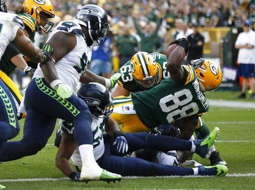 Green Bay Packers' Ty Montgomery runs for a touchdown during the second half of an NFL football game against the Seattle Seahawks Sunday, Sept. 10, 2017, in Green Bay, Wis. (AP Photo/Mike Roemer)