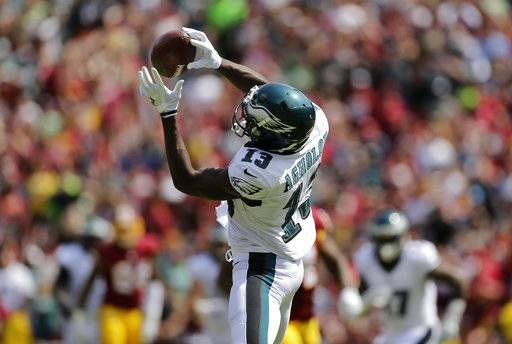 Philadelphia Eagles wide receiver Nelson Agholor catches a pass before rushing for a touchdown in the first half of an NFL football game against the Washington Redskins, Sunday, Sept. 10, 2017, in Landover, Md. (AP Photo/Mark Tenally)