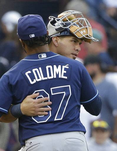 Tampa Bay Rays' Wilson Ramos, right, celebrates with Alex Colome, left, after they defeated the Boston Red Sox in a baseball game, Sunday, Sept. 10, 2017, in Boston. (AP Photo/Steven Senne)