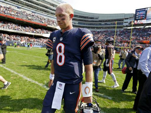 Chicago Bears quarterback Mike Glennon (8) walks off the field after an NFL football game against the Atlanta Falcons, Sunday, Sept. 10, 2017, in Chicago. The Falcons won 23-17. (AP Photo/Michael Conroy)