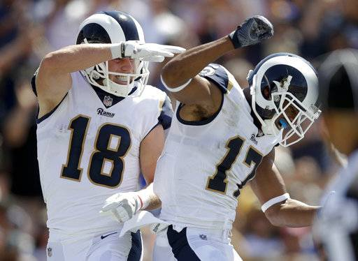 Los Angeles Rams wide receiver Cooper Kupp, left, celebrates his touchdown with wide receiver Robert Woods during the first half of an NFL football game against the Indianapolis Colts, Sunday, Sept. 10, 2017, in Los Angeles. (AP Photo/Jae C. Hong)