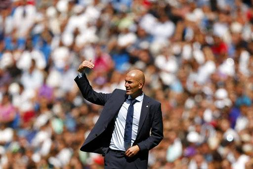 Real Madrid's head coach Zinedine Zidane gives instructions from the side line during the Spanish La Liga soccer match between Real Madrid and Levante at the Santiago Bernabeu stadium in Madrid, Saturday, Sept. 9, 2017. The match ended in a 1-1 draw. (AP Photo/Francisco Seco)
