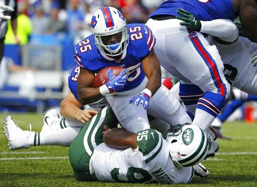 New York Jets' Josh Martin (95) tackles Buffalo Bills' LeSean McCoy (25) during the first half of an NFL football game, Sunday, Sept. 10, 2017, in Orchard Park, N.Y. (AP Photo/Jeffrey T. Barnes)