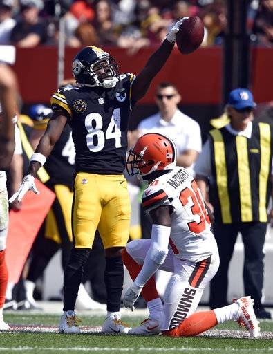 Pittsburgh Steelers wide receiver Antonio Brown (84) celebrates a first down catch as Cleveland Browns defensive back Jason McCourty (30) watches during the second half of an NFL football game, Sunday, Sept. 10, 2017, in Cleveland. (AP Photo/David Richard)