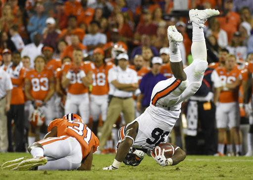 Auburn running back Kamryn Pettway (36) is tackled by Clemson cornerback Ryan Carter (31) during the second half of an NCAA college football game, Saturday, Sept. 9, 2017, in Clemson, S.C. (AP Photo/Rainier Ehrhardt)