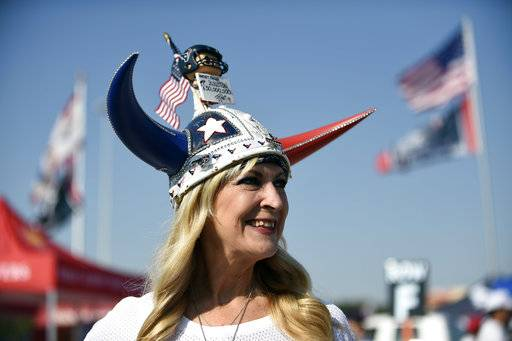 "Houston Texans fan Pati Cream arrives for an NFL football game between the Houston Texans and the Jacksonville Jaguars, Sunday, Sept. 10, 2017, in Houston. Cream is part of an organization called the ""Super Fan Alliance"" that connects fans from around the league. In the days after Harvey struck, fans in the cities of every team and even some in Mexico reached out offering help. (AP Photo/Eric Christian Smith)"