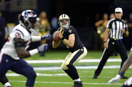 FILE - IN this Aug. 26, 2017, file photo, New Orleans Saints quarterback Drew Brees (9) drops back to pass during the team's preseason NFL football game against the Houston Texans in New Orleans. Brees and the Saints open their season against the Minnesota Vikings. Brees led the NFL in passing yards for a record seventh time in 2016. In five career games against the Vikings, he's 4-1 with a 69 percent completion rate and an average of 294 yards passing per game. He has only thrown four interceptions and taken four sacks. (AP Photo/Bill Feig, File)