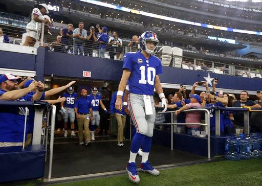 New York Giants quarterback Eli Manning (10) walks onto the field for warm ups before an NFL football game gains the Dallas Cowboys on Sunday, Sept. 10, 2017, in Arlington, Texas. (AP Photo/Michael Ainsworth)