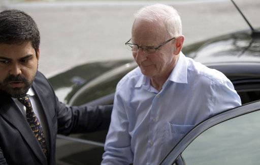 FILE- In this Tuesday, Sept. 6, 2016 file photo, Ireland's Olympic Council President Patrick Hickey arrives to a police station in Rio de Janeiro, Brazil. The IOC said Sunday, Sept. 10, 2017, Patrick Hickey resigned from its executive board, more than one year after he was arrested at the Rio de Janeiro Olympics in a ticket scalping investigation. (AP Photo/Mauro Pimentel, File)