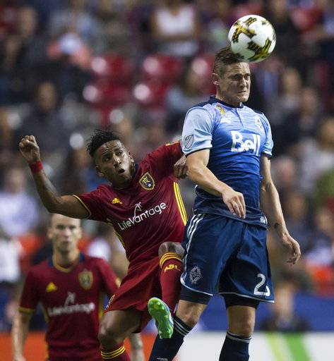 Vancouver Whitecaps' Jake Nerwinski, right, gets his head on the ball in front of Real Salt Lake's Joao Plata during the second half of an MLS soccer match Saturday, Sept. 9, 2017, in Vancouver, British Columbia. (Darryl Dyck/The Canadian Press via AP)