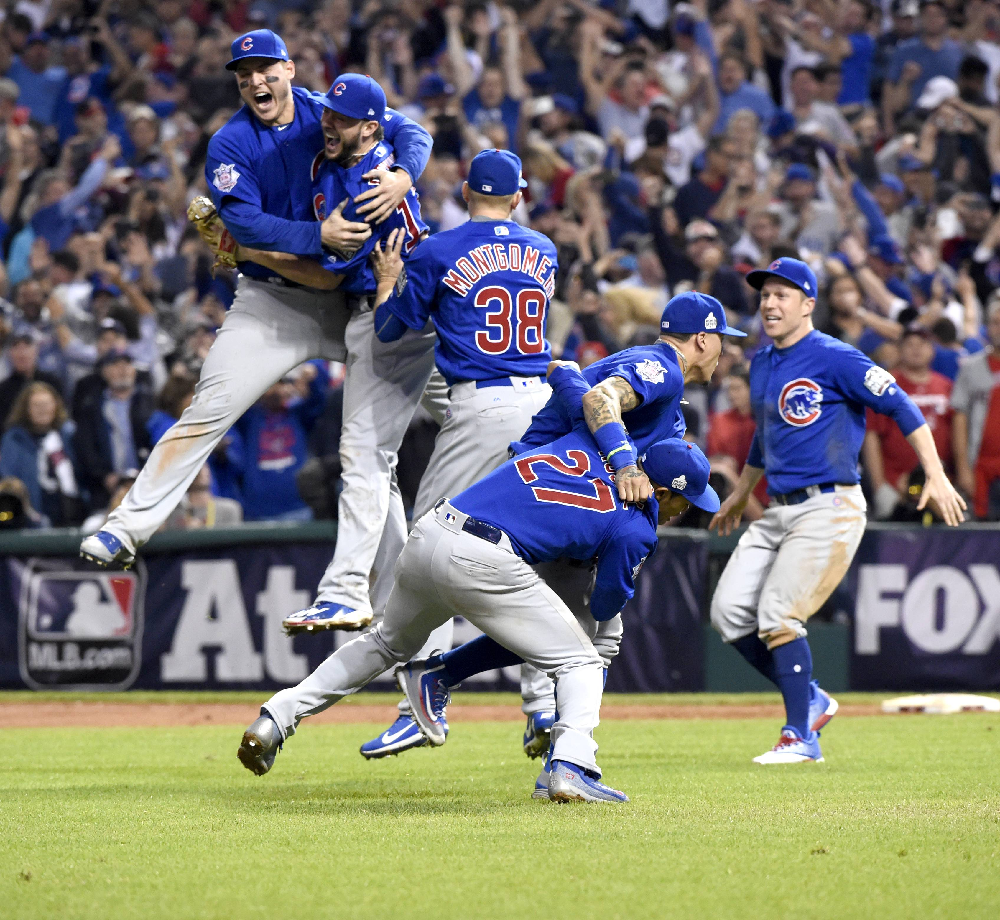 The Chicago Cubs celebrate their win during Game 7 of baseball's World Series in Cleveland.