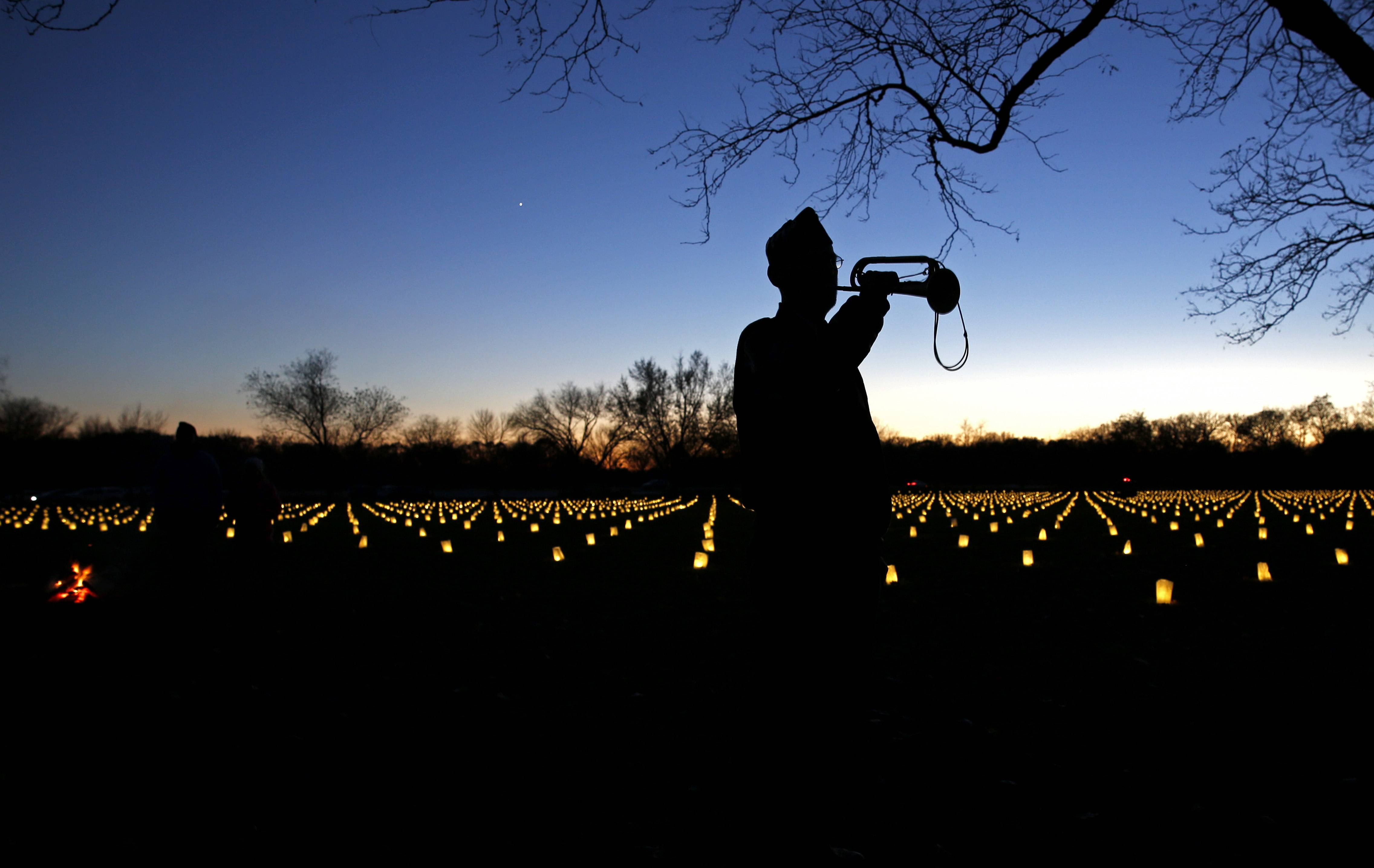 Bugler John Pierce of Cantigny Post 556 opens the Cantigny Parade Field, which honors those who died fighting for the First Division during World War l.