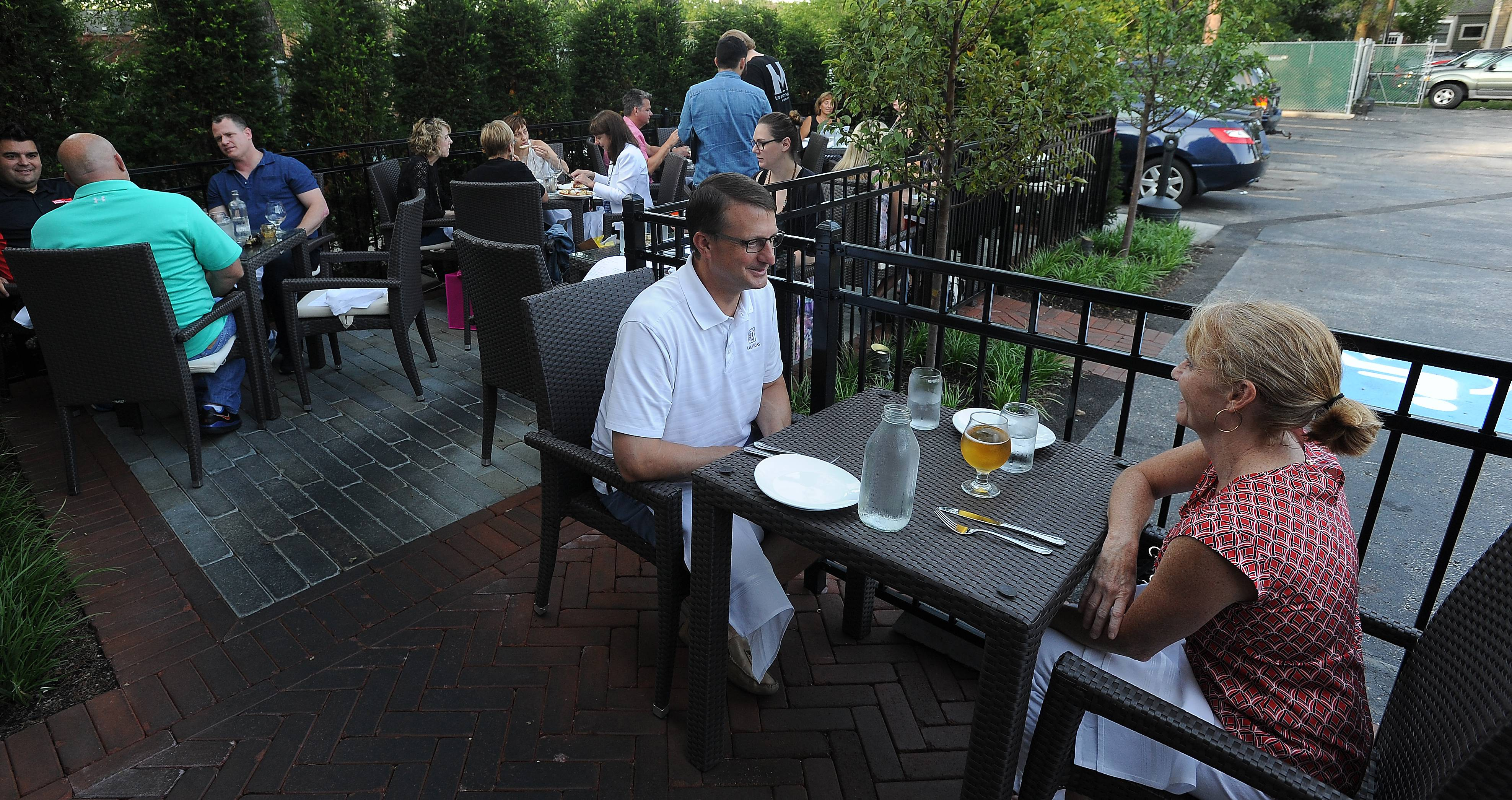 Main Street Social restaurant in Libertyville is one of the many establishments that offer outdoor seating. Tony and Cathie Saia of Libertyville enjoy the fresh air.