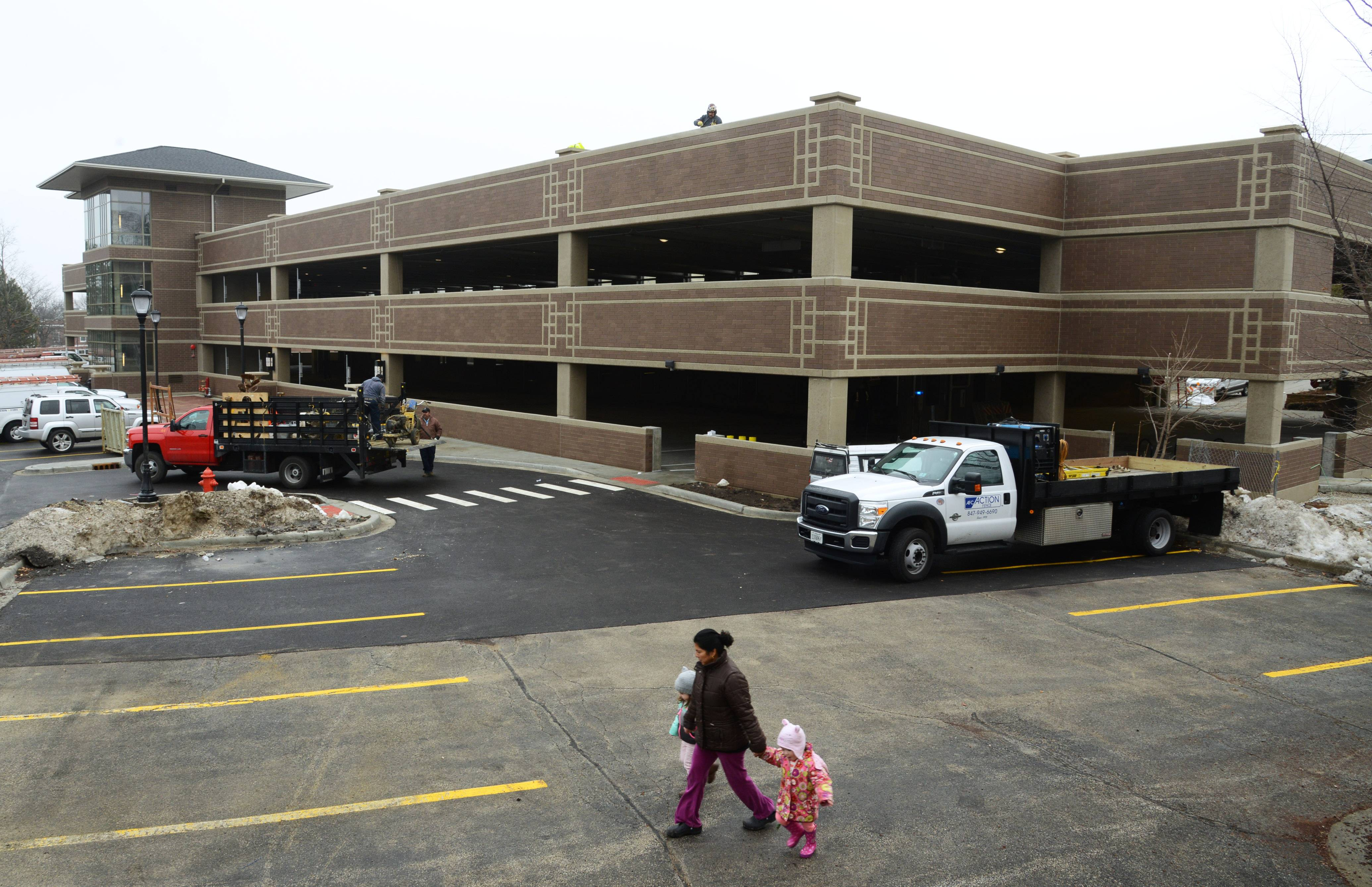 Parking problems plague successful downtowns. Libertyville recently added a second parking deck.