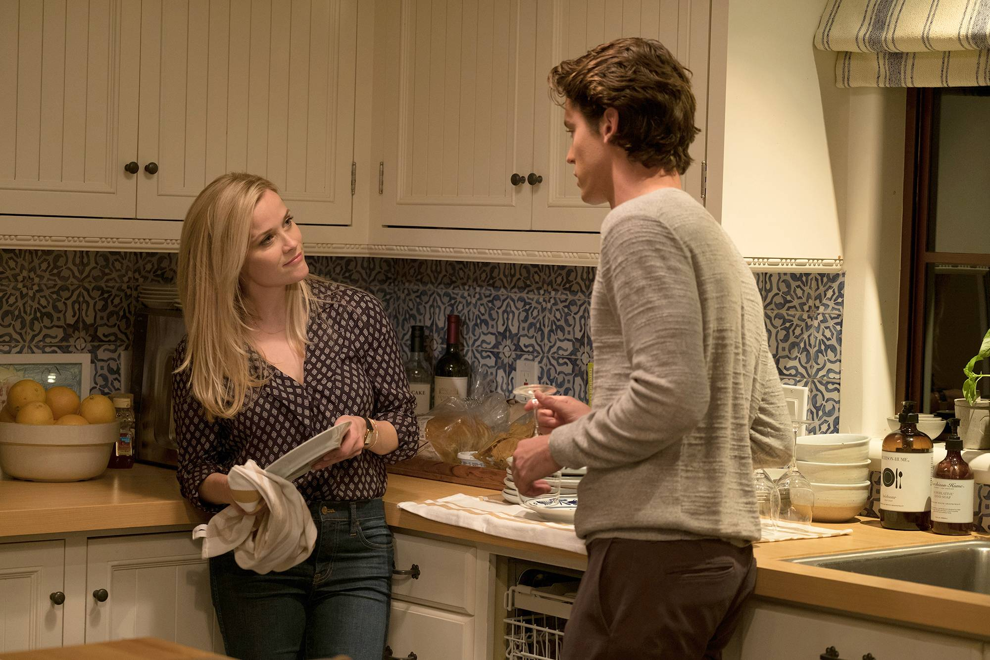 "Reese Witherspoon and Pico Alexander star in ""Home Again."""