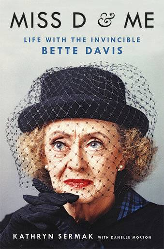 "This cover image released by Hachette Books shows ""Miss D and Me: Life with the Invincible Bette Davis"" by Kathryn Sermak and with Danelle Morton. (Hachette Books via AP)"