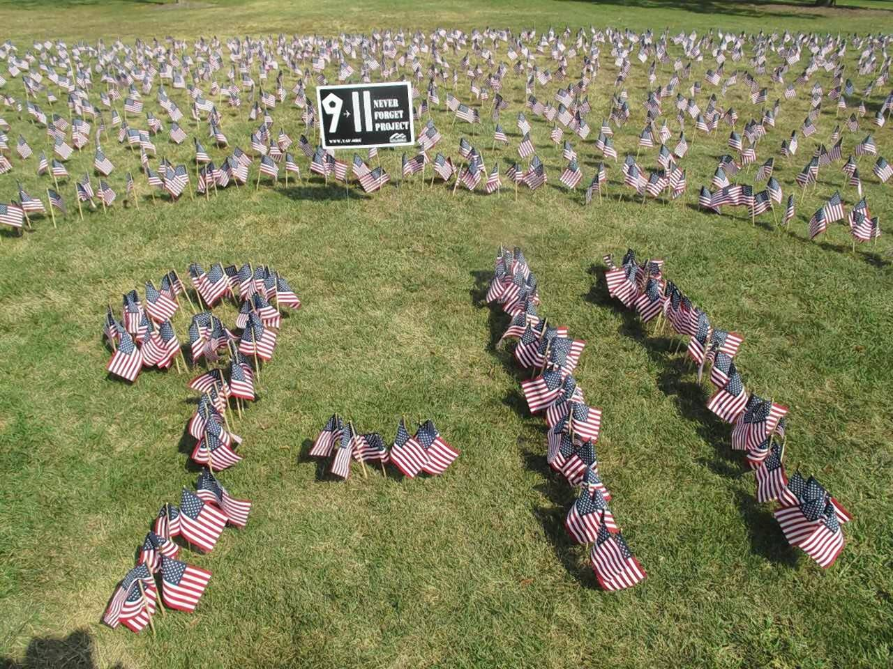 A display of tiny flags -- one to represent each victim who died in the Sept. 11 terrorist attacks -- takes up the lawn north of the Memorial Student Center at Wheaton College.