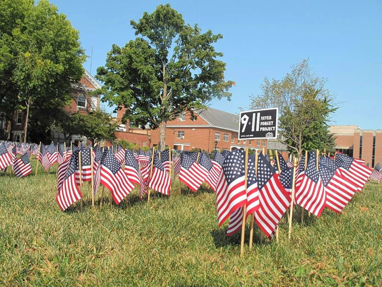 Flags to represent the life of each person who died in the Sept. 11 terrorist attacks catch students' attention on Monday at Wheaton College.