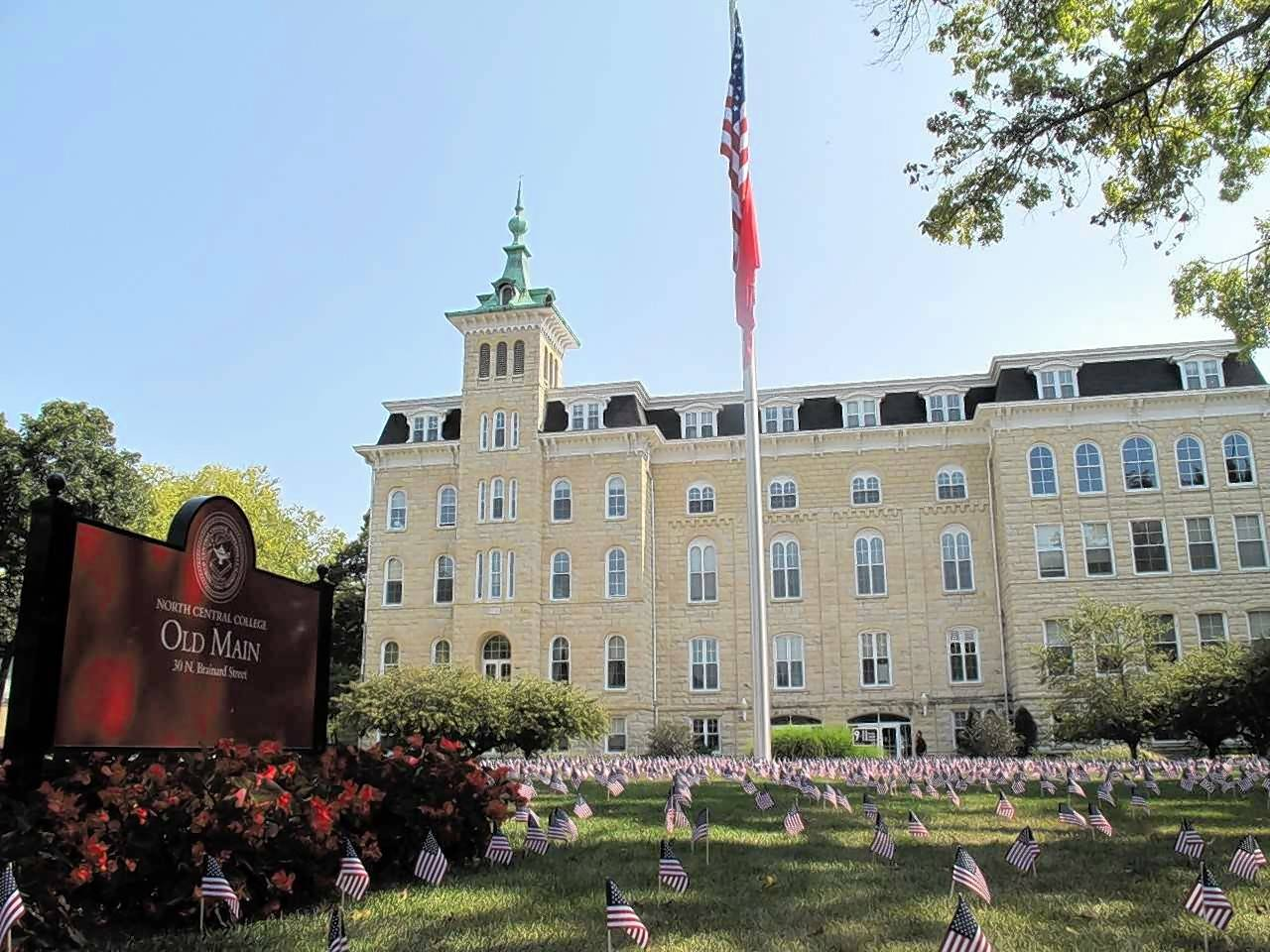 A display of 2,977 flags to represent the victims of the Sept. 11 terrorist attacks takes up the lawn west of Old Main at North Central College in Naperville as part of the Never Forget Project, which involves similar flag setups at more than 200 campuses.