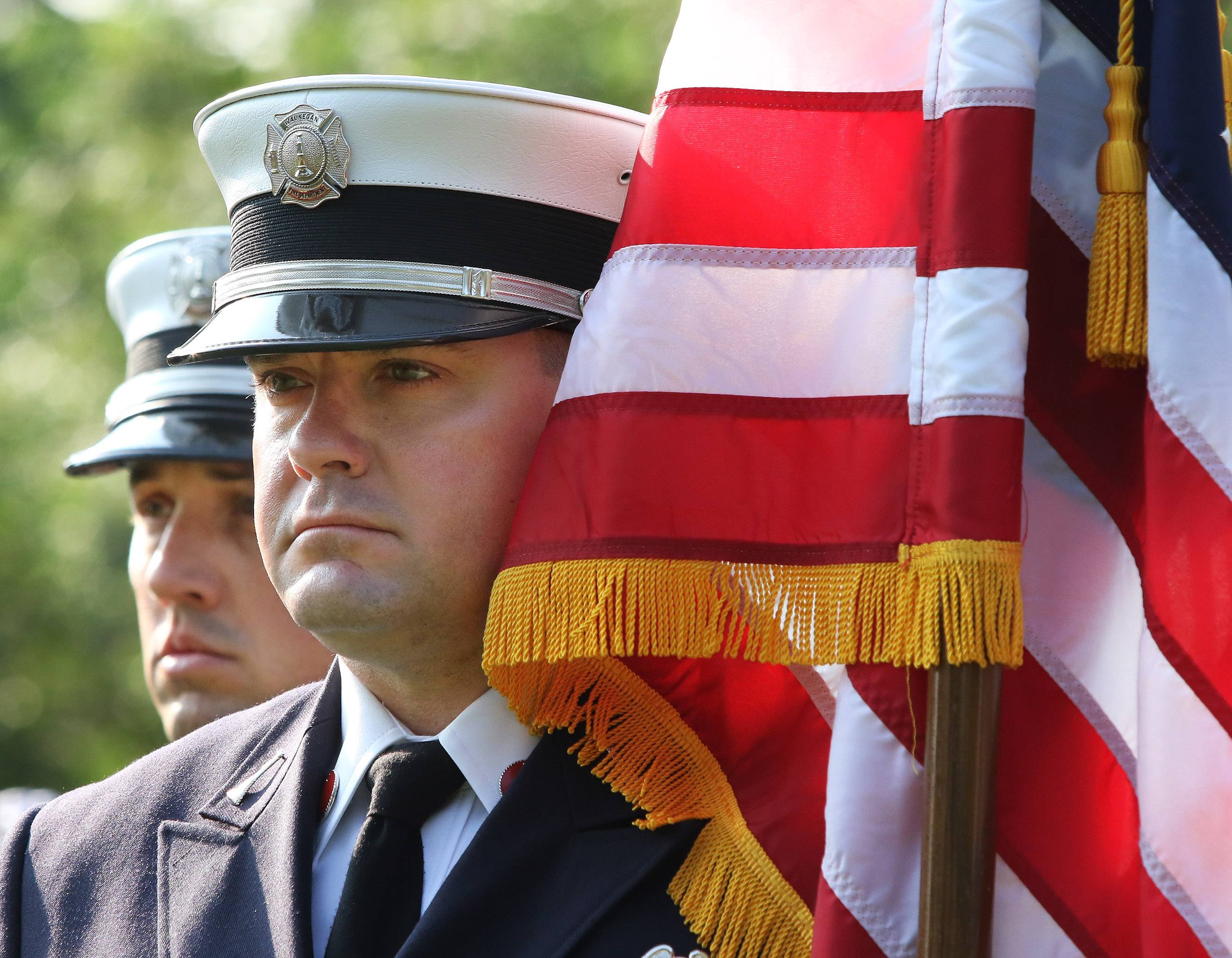 Waukegan Fire Dept. Lt. Jeremy Brown, right, and Lt. John Carrier listen to the bells ring during the 9/11 Remembrance Ceremony at Fireman's Memorial Park in Waukegan on Monday. The Waukegan Fire Department hosted the event that recognized firefighters and police officers lost on September 11, 2001 terrorist attack.