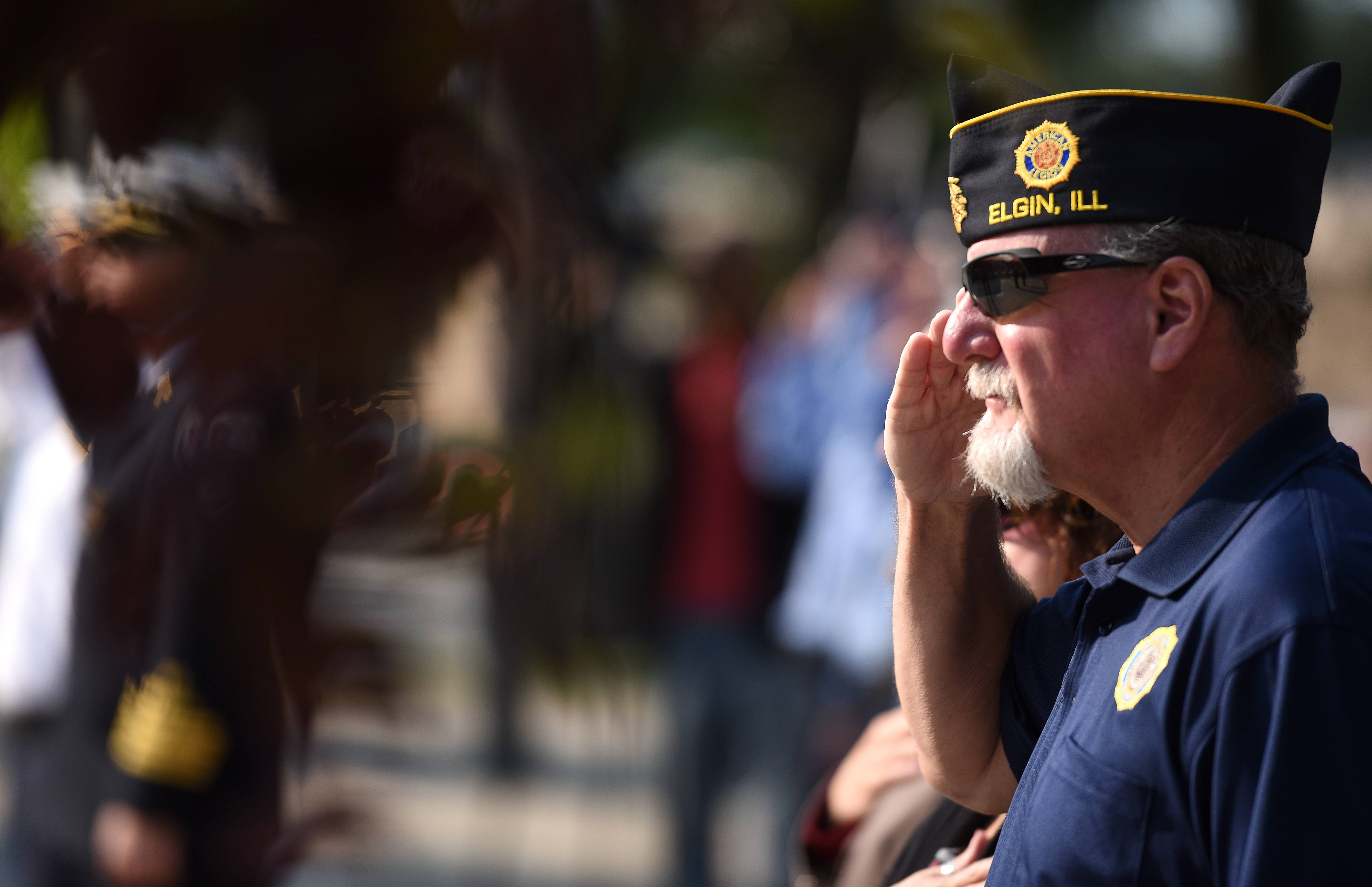 Craig Essick of Elgin salutes as the colors are posted during Elgin's Sept. 11 remembrance Monday. Essick, an Army veteran, is commander of Elgin American Legion Post 57.