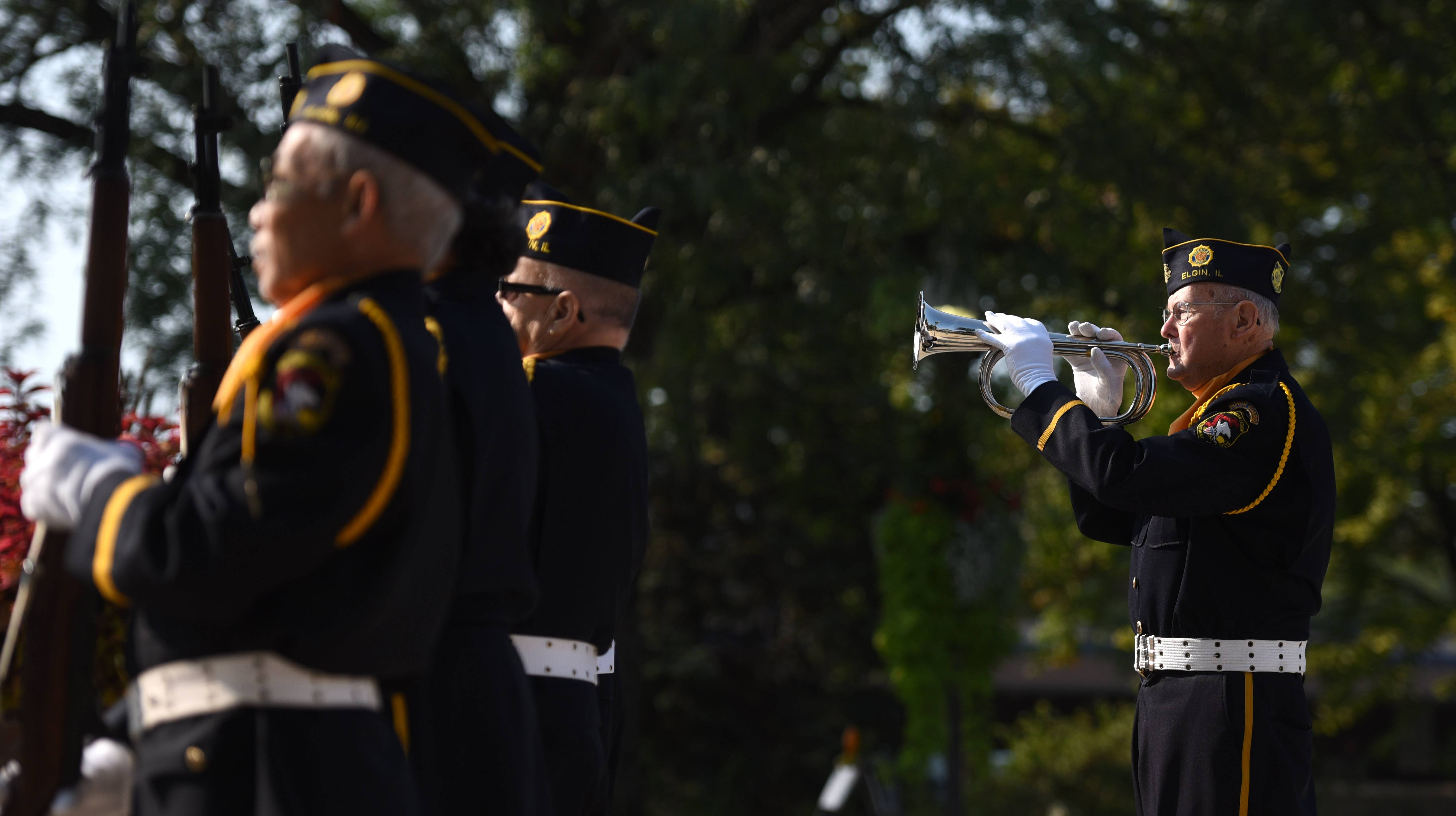 Don Sleeman of Elgin American Legion Post 57 plays taps on the bugle during Elgin's Sept. 11 remembrance Monday.