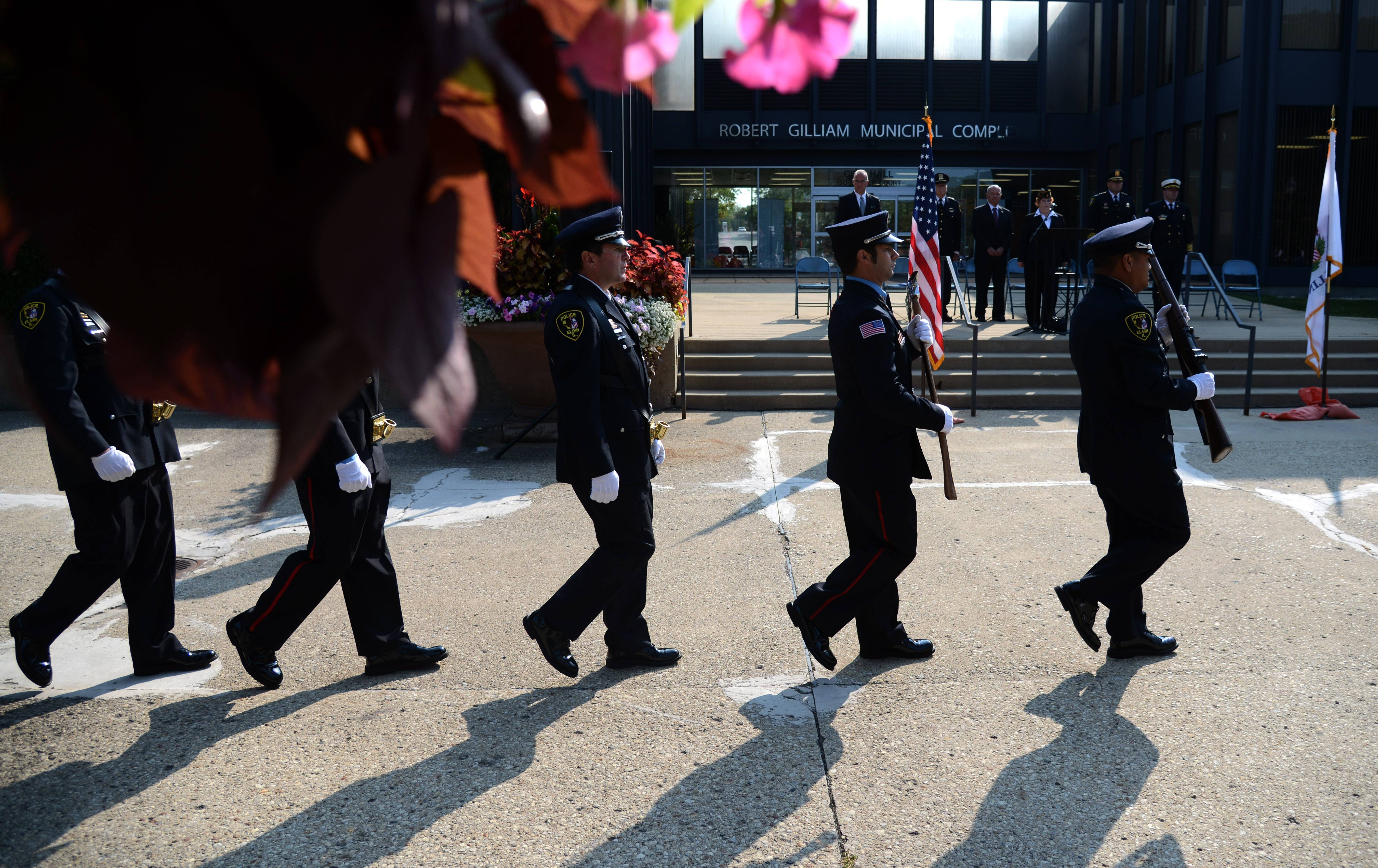 The Elgin Police color guard posts the colors during Elgin's Sept. 11 ceremony Monday.
