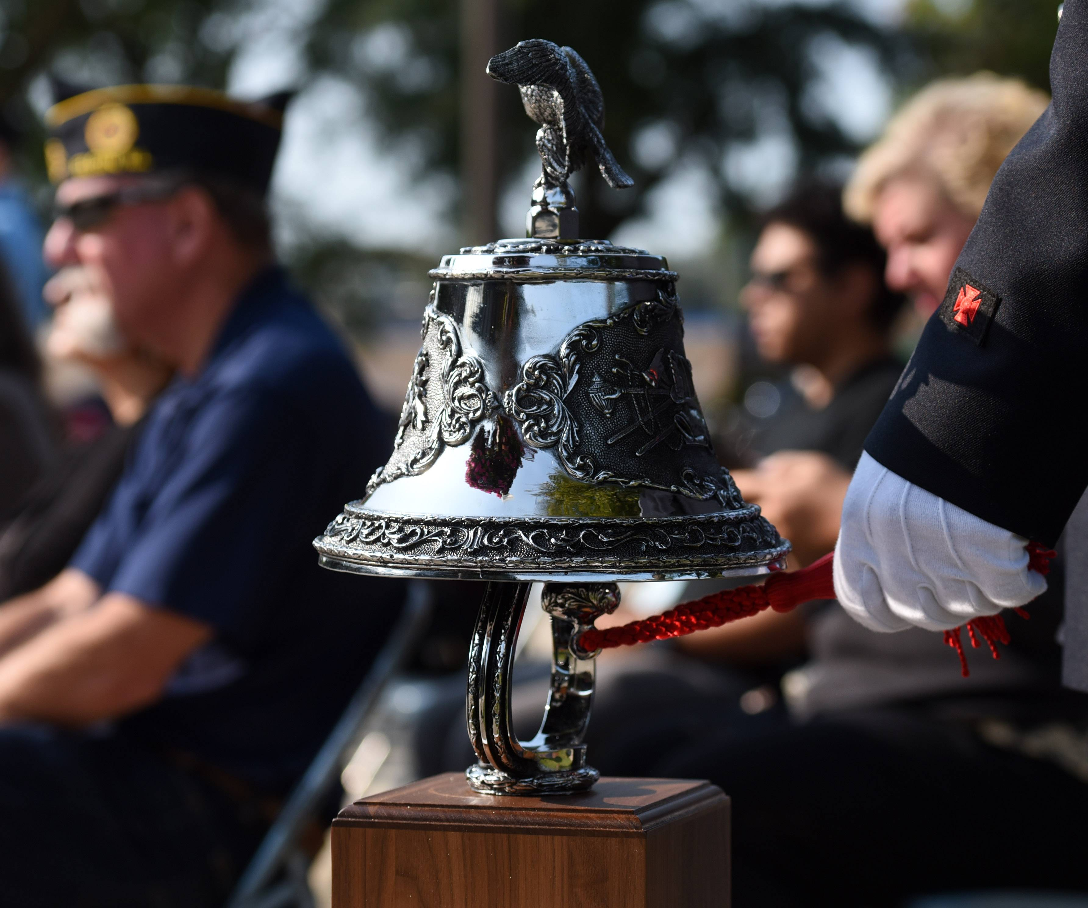 Elgin firefighter Kanen Terry rings the bell to honor those who died in the Sept. 11 terrorist attacks during Elgin's remembrance ceremony Monday.