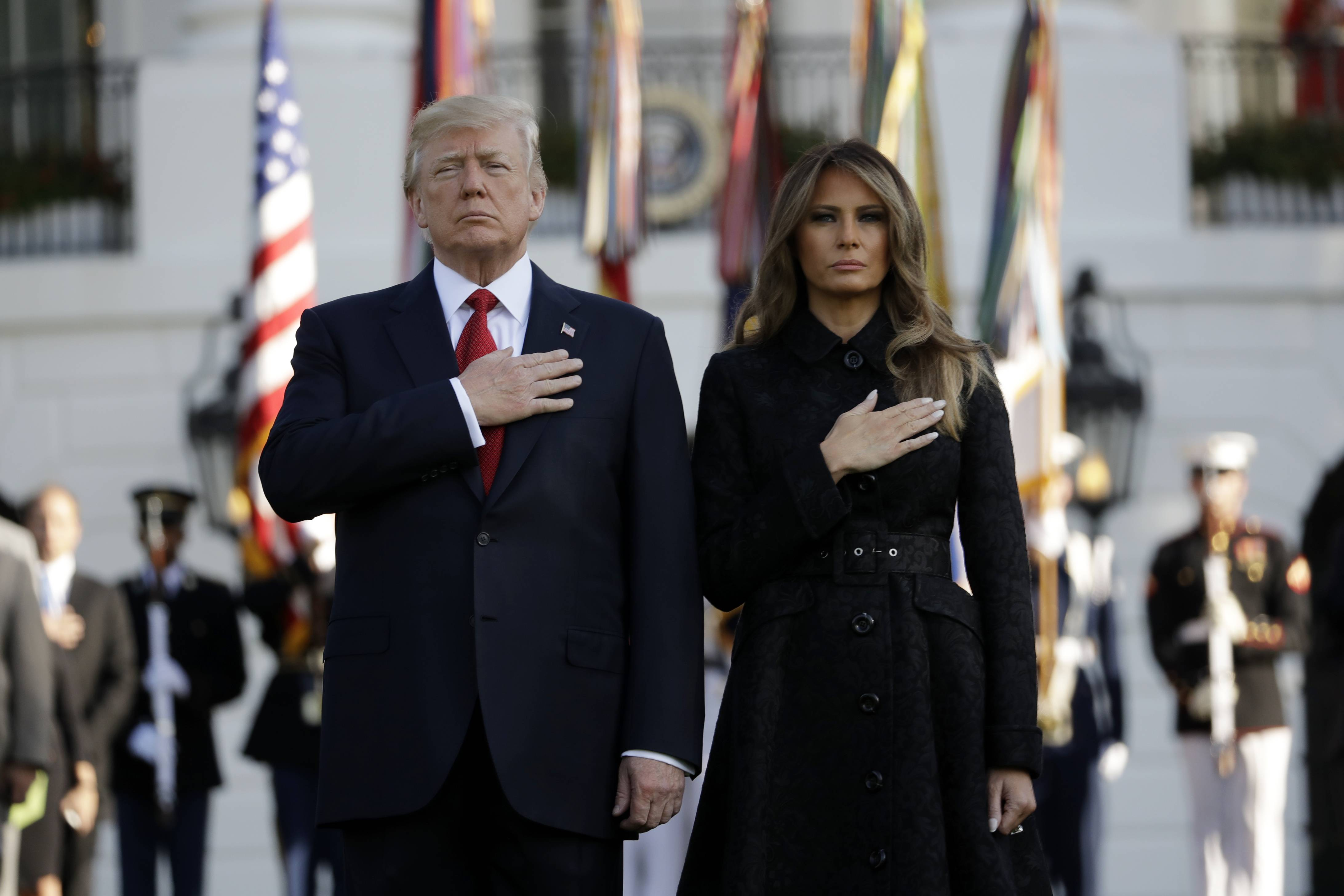 President Donald Trump and first lady Melania Trump stand for a moment of silence to mark the anniversary of the Sept. 11 terrorist attacks, on the South Lawn of the White House, Monday, Sept. 11, 2017, in Washington.