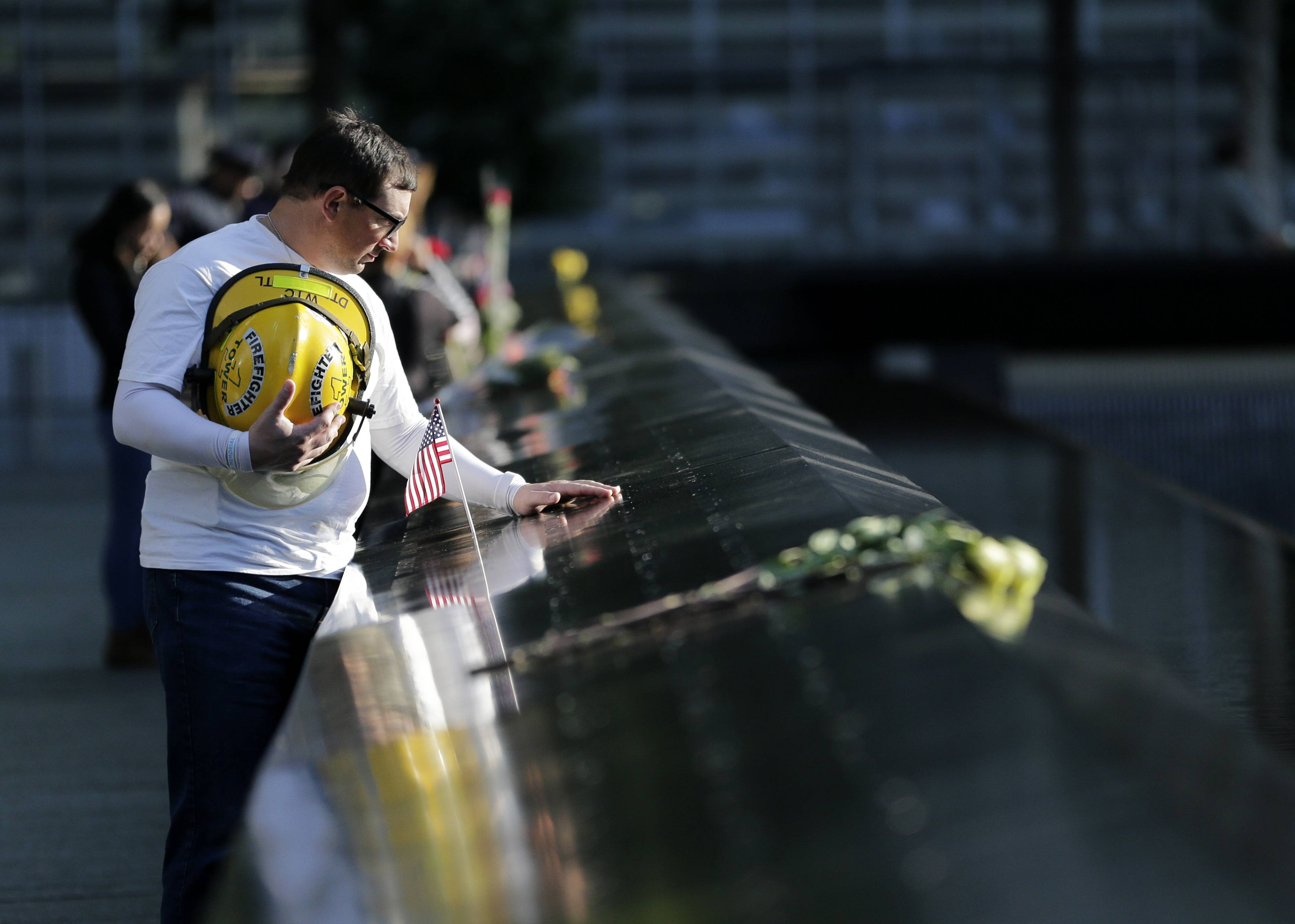James Taormina, whose brother Dennis Taormina was killed during the Sept. 11 attacks stands by the side of the north waterfall pool before the a ceremony at ground zero in New York, Monday, Sept. 11, 2017. Holding photos and reading names of loved ones lost 16 years ago, 9/11 victims' relatives marked the anniversary of the attacks with a solemn and personal ceremony.