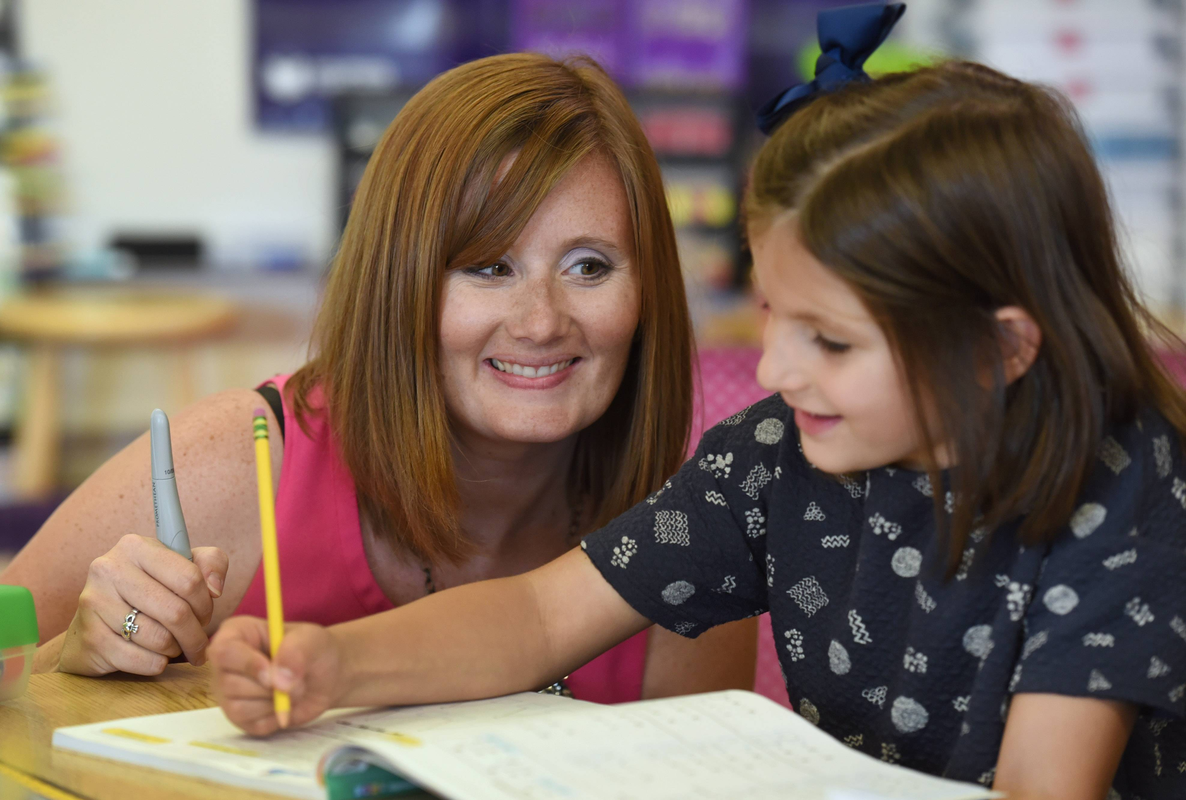 Adler Park Elementary School first-grade teacher Ashley Zeinz works on a math lesson with student Valentina Milanovic-Martin.