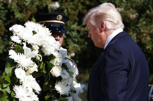 President Donald Trump lays a wreath during a ceremony to mark the anniversary of the Sept. 11 terrorist attacks, Monday, Sept. 11, 2017, at the Pentagon. (AP Photo/Evan Vucci)