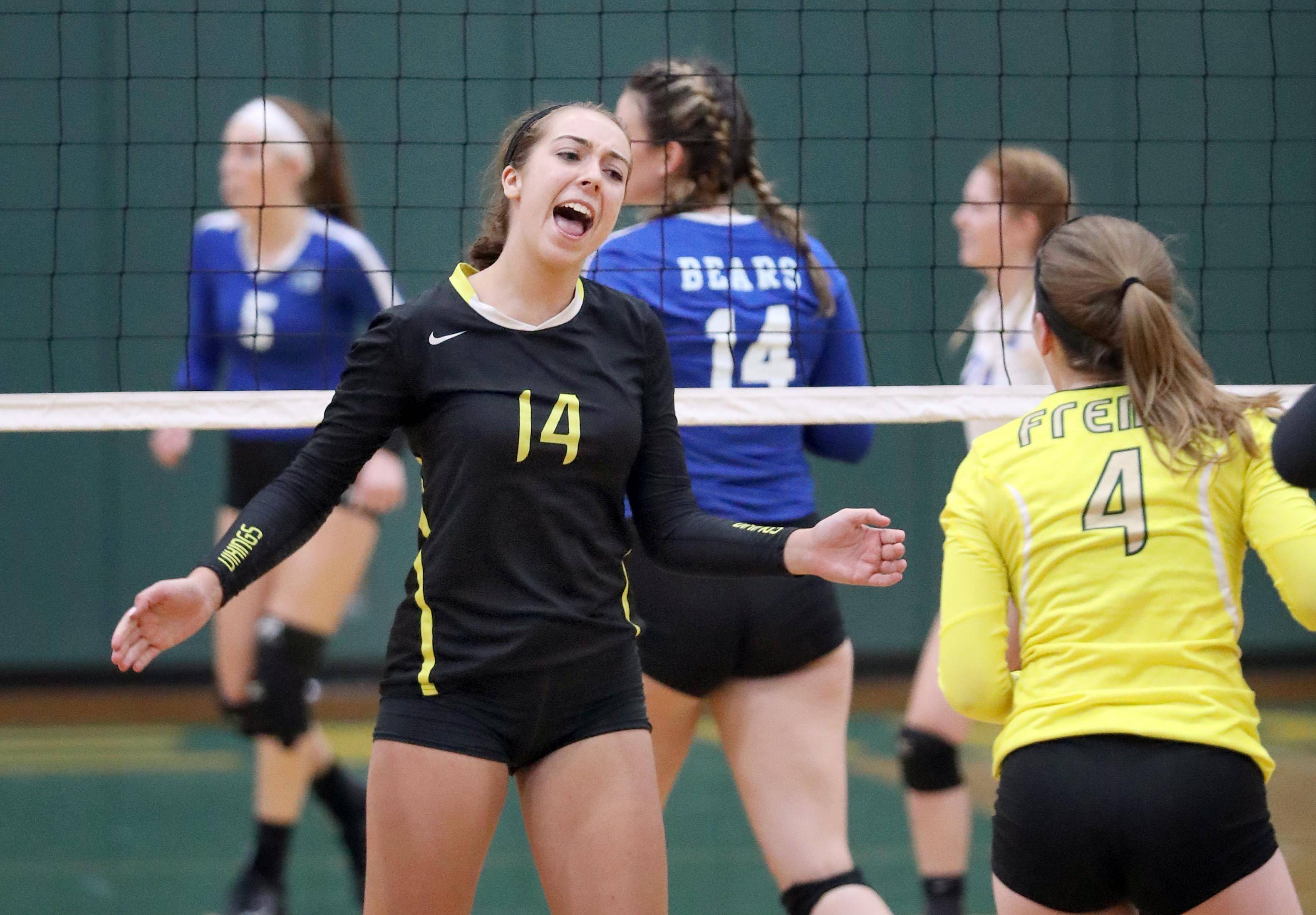 Fremd's Jess Rizzo (14) celebrates with Maddie Aichinger against Lake Zurich Monday night in Palatine.