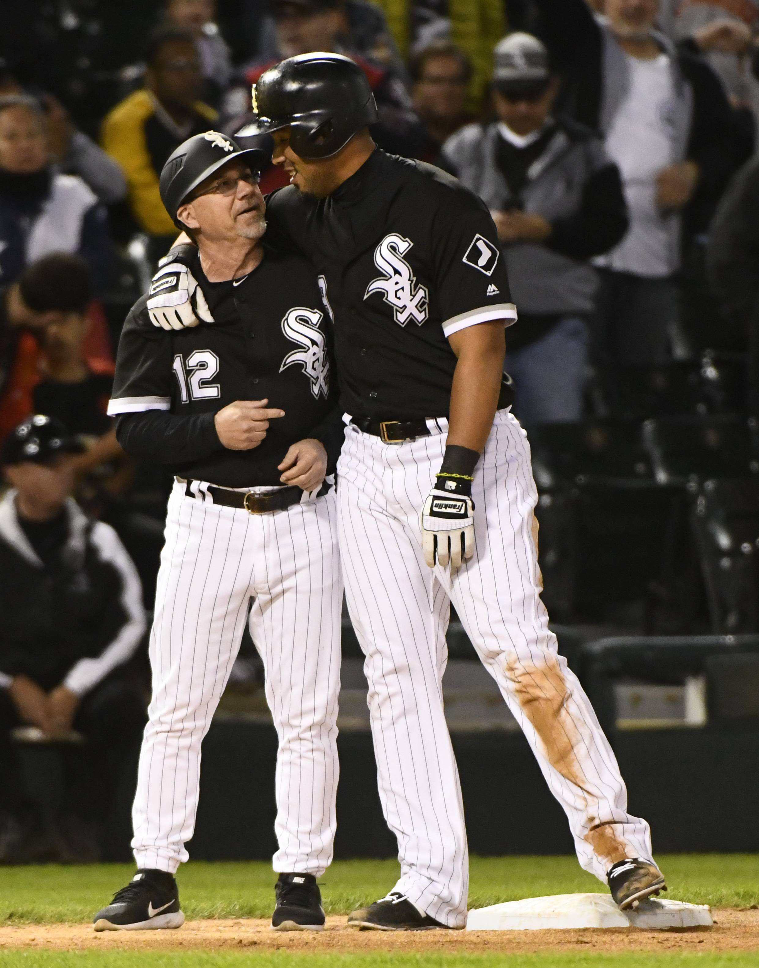 Chicago White Sox's Jose Abreu, right, hugs third base coach Nick Capra (12) after hitting a triple for the cycle against the San Francisco Giants during the eighth inning of a baseball game in Chicago, Saturday, Sept. 9, 2017. (AP Photo/Matt Marton)