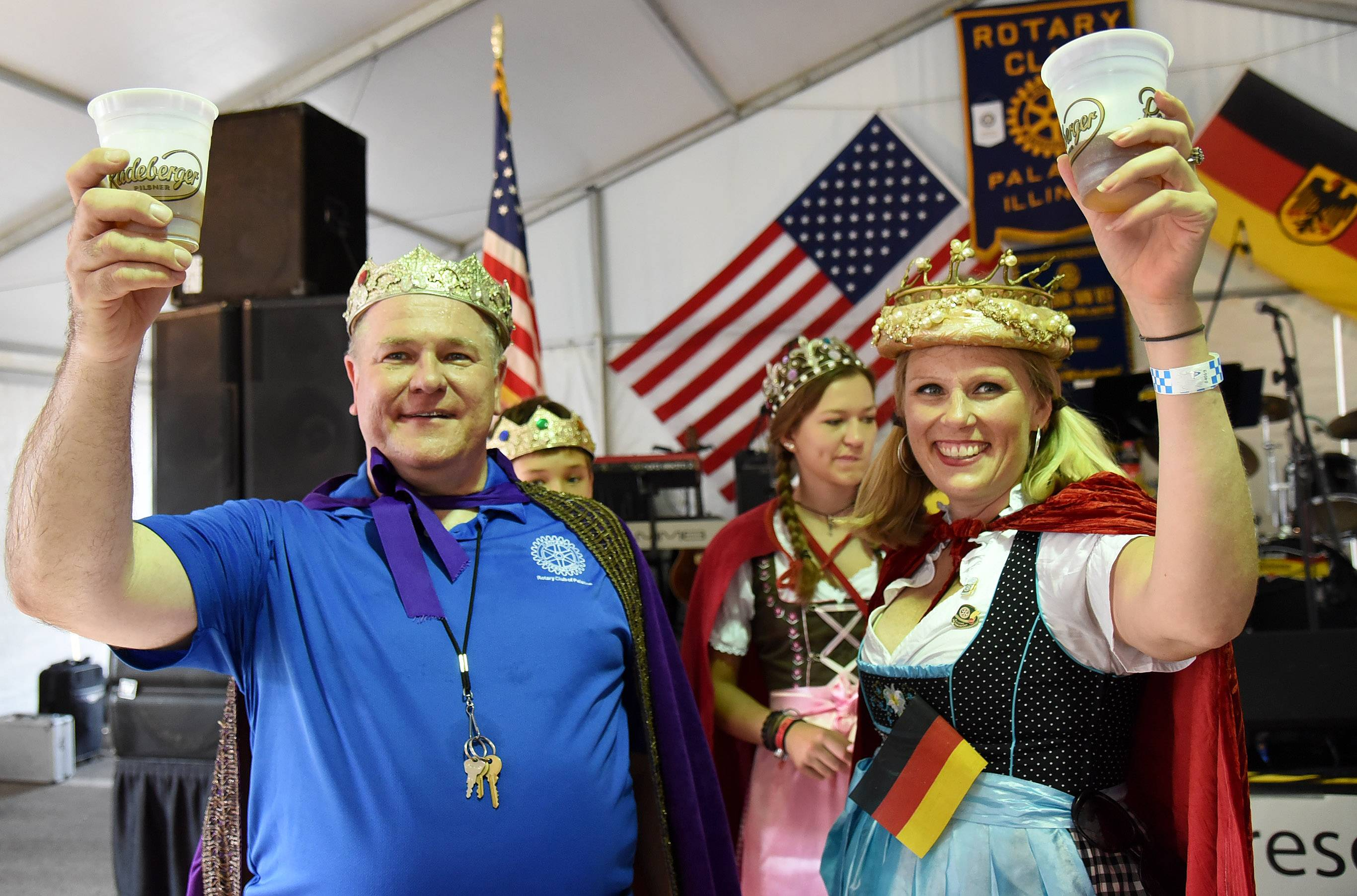 Oktoberfest king and queen Hank Sobotka, president of the Rotary, and Jaime Suszek, Rotary youth exchange officer, raise their cups in a toast to kick off the three-day Rotary of Palatine Oktoberfest celebration last year.